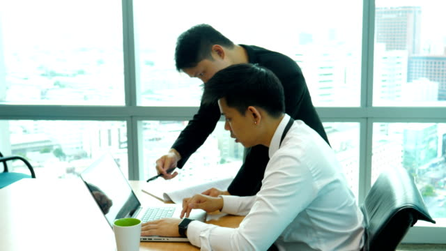 Two businessman have a meeting and discussion in office video
