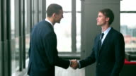 Two businessman shaking hands video
