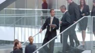 DS Two businessman talking over tablet on the stairs video