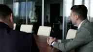 Two businessmen are talking in a meeting room. video