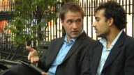 Two Businessmen Brainstorming on a Digital Tablet Computer video