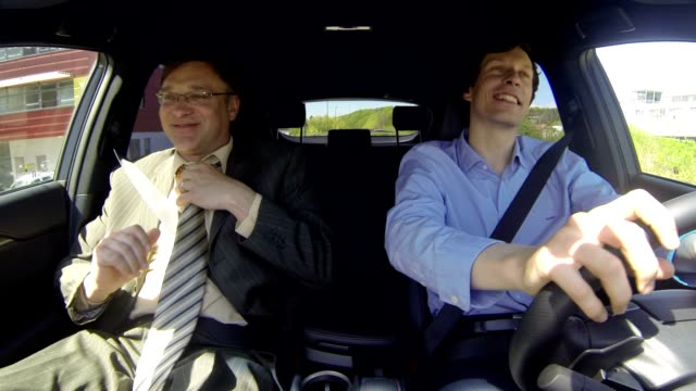 Two businessmen in the car video
