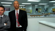 Two businessmen look annoyed with female coworker video