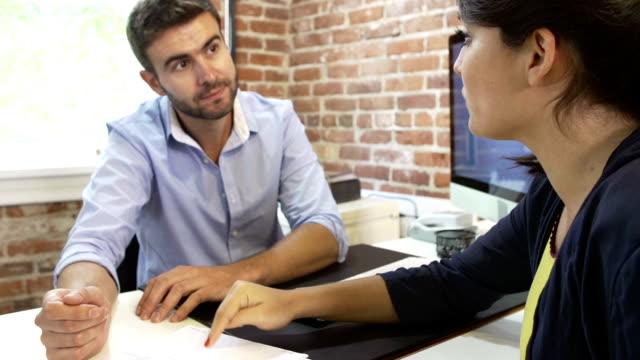 Two Businesspeople Having Meeting In Design Studio video