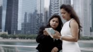 Two Businesswomen Discussing Idea on Tablet Screen video