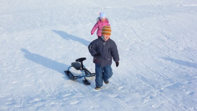 Two children with sled video
