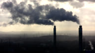 two chimneys with smoke video