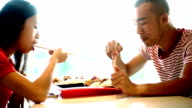 Two Chinese people having lunch. video