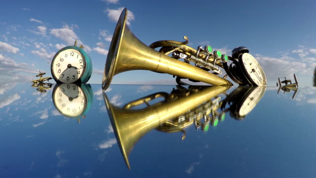 Two clocks and a trumpet on the mirror beneath the cloudy sky, time lapse video