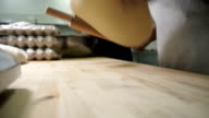 two cookers work with dough on board in industrial kitchen setting video