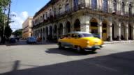 Two cuban vintage cars crossing the street in La Habana, Cuba video