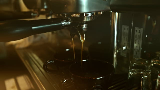 Two Cups of Espresso Being Poured video