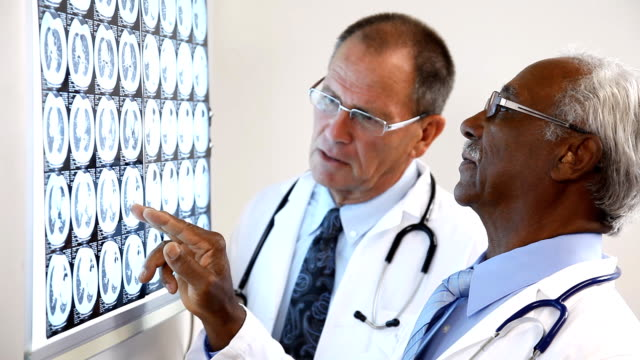 Two Doctors Consulting On X-Ray video