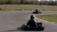 Two drivers in karts are moving very slowly on a ride. Go kart track video