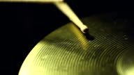 Two drum sticks hitting a cymball video