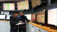Two Engineer Checking in control room video