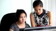 Two Female Asian Office Workers Discussing Project video
