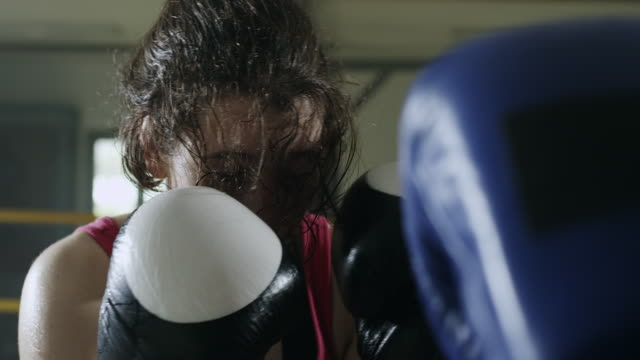 Two female boxers boxing in the boxing ring video
