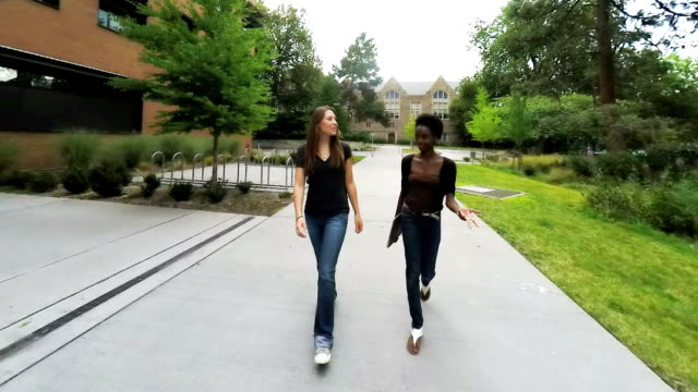 Two Female College Students Walking and Talking video