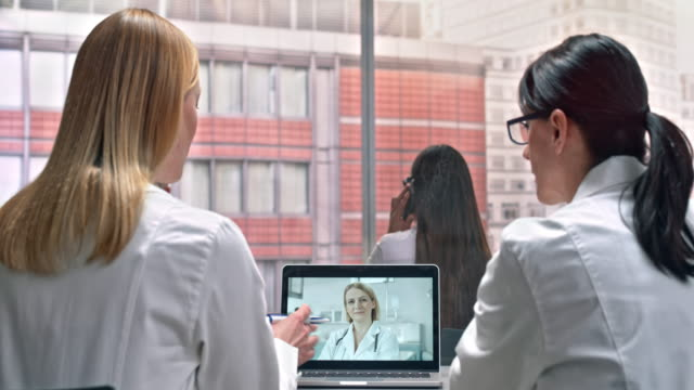 DS Two female doctors on a video call with their laboratory colleague video