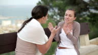 Two female friends arguing outdoors video