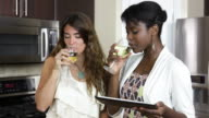 Two female friends drinking wine. video