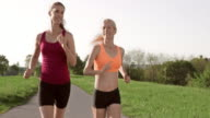 SLO MO TS Two female friends enjoying their run video