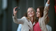 SLO MO two female friends making shopping selfies video
