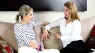 Two female friends talking video