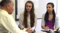 Two Female Students Talking To High School Counselor video