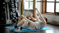 Two friends, fat guy and athlete, train abdominal muscles video