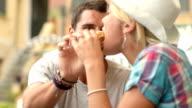 Two friends have italian breakfast eating brioche CU video