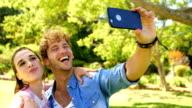 Two friends taking a selfie video