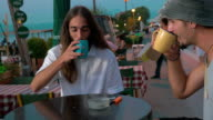 Two friends talking in cafe on waterfront video