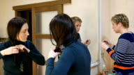 Two girl friends gossiping in dressing makeup room video