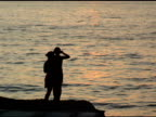 Two girlfriends dance and take photo of Mexican sunset 2 video