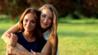 Two girlfriends hugging very video