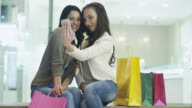 Two Girls are doing Selfie with the Phone after Shopping. video