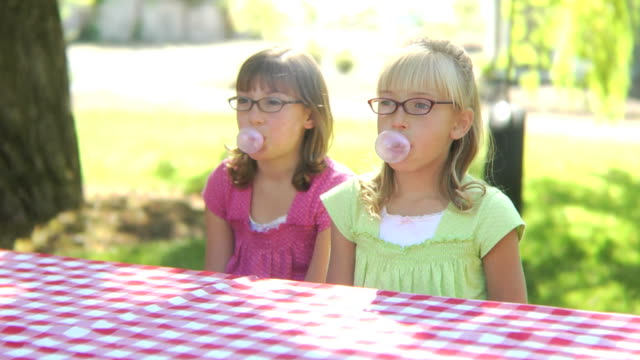 Two girls blowing bubbles video