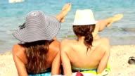 Two girls enjoying the beach video