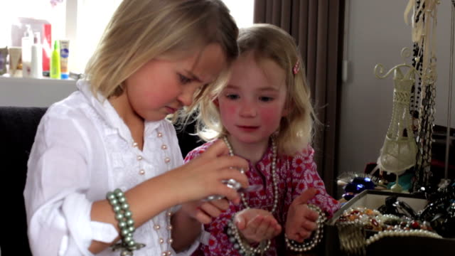 Two Girls Filing Nails And Playing With Jewelry In Bedroom video