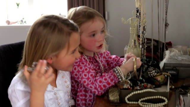 Two Girls Playing With Jewelry And Perfume In Bedroom video