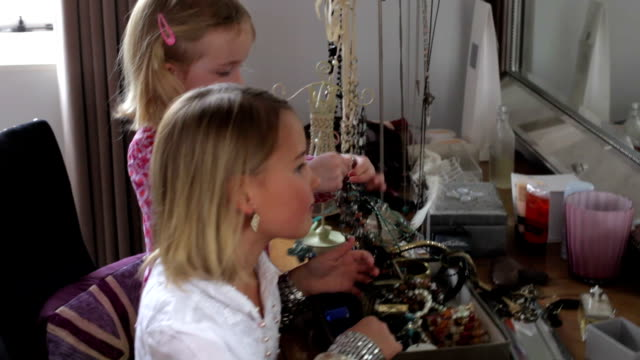 Two Girls Playing With Jewelry In Parents Bedroom video