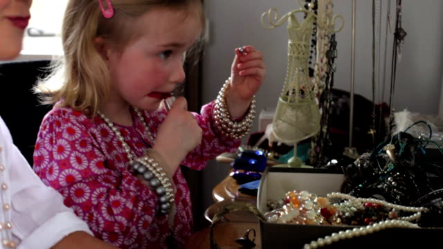 Two Girls Putting On Make Up And Playing With Jewelry video