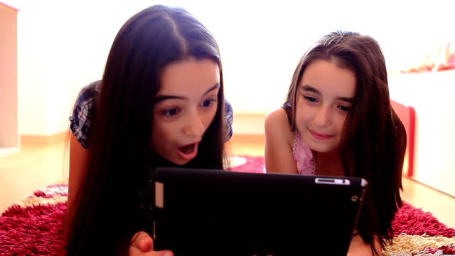 Two girls using a tablet computer video
