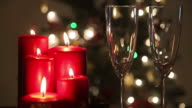 Two glasses and red candles with champagne video