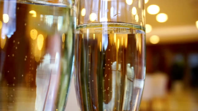 Two glasses of champagne waiting to be served by guests video