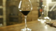 Two glasses of red wine in wine-cellar video