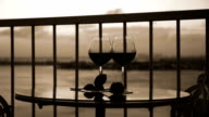 Two glasses with wine on balcony video