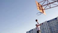 Two guy play basketball at district sports ground. video